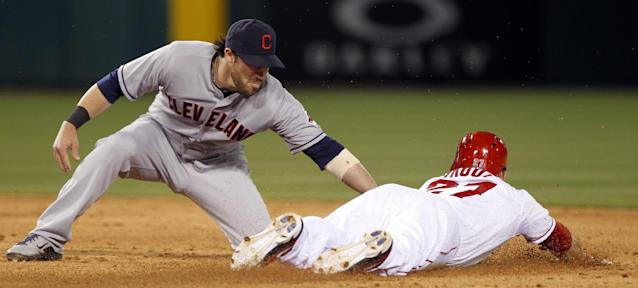 Los Angeles Angels' Mike Trout, right, steals second base as Cleveland Indians second baseman Jason Kipnis applies the late tag in the third inning of a baseball game Tuesday, April 29, 2014, in Anaheim, Calif. (AP Photo/Alex Gallardo)