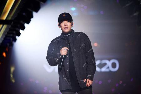 Chinese rap singer PG One performs during a New Year concert in Guangzhou
