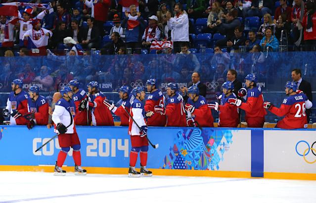 SOCHI, RUSSIA - FEBRUARY 19: Ales Hemsky #83 of the Czech Republic celebrates wuith his bench after scoring a goal against Jonathan Quick #32 of the United States in the first period during the Men's Ice Hockey Quarterfinal Playoff on Day 12 of the 2014 Sochi Winter Olympics at Shayba Arena on February 19, 2014 in Sochi, Russia. (Photo by Martin Rose/Getty Images)