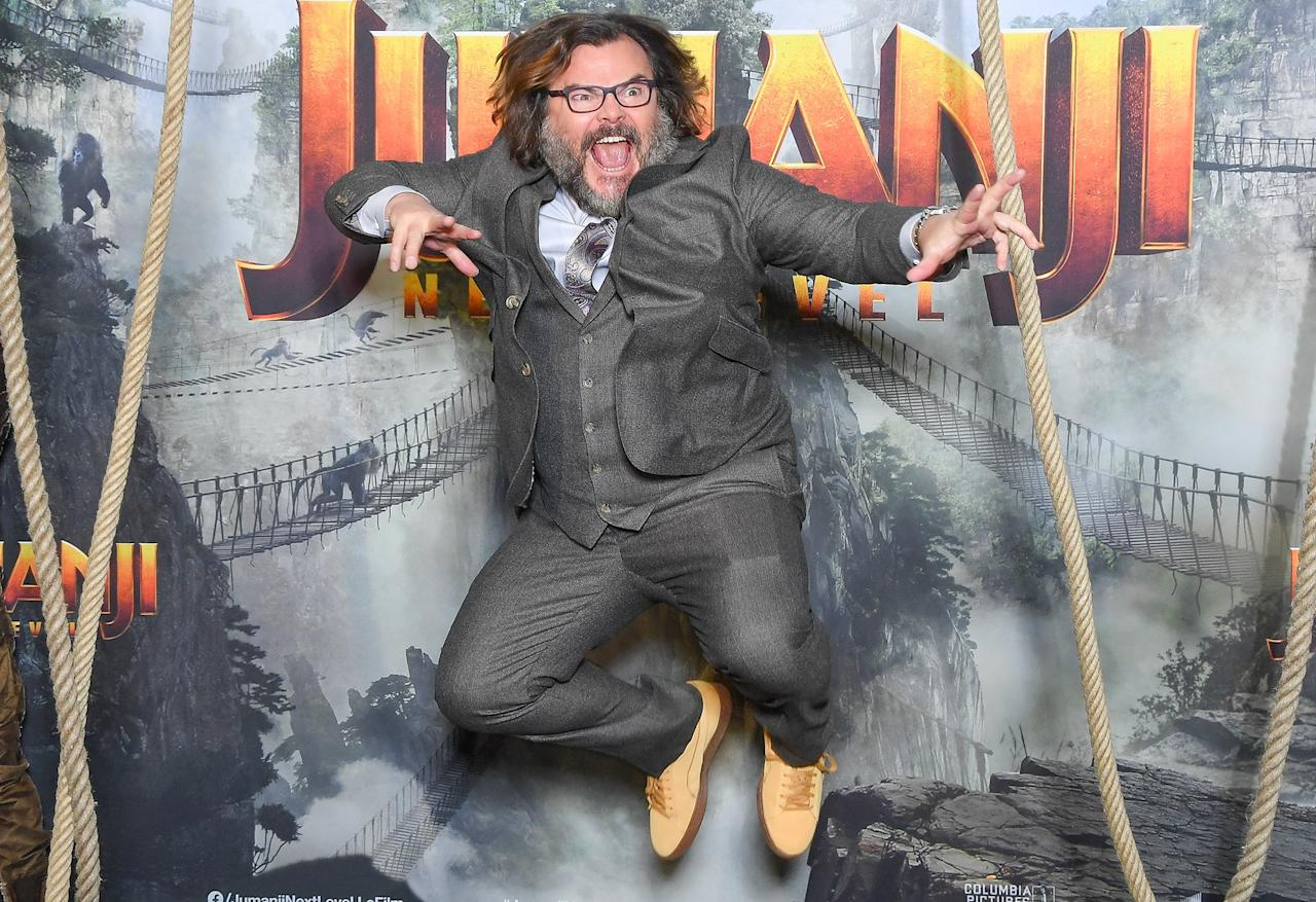 Jack Black reaches new heights on Tuesday at a photo call for <em>Jumanji: Next Level</em> in Paris.
