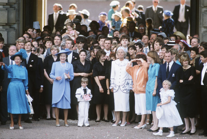 LONDON - JULY 23: Queen Elizabeth II surrounded by family and friends bid farewell to the Duke and Duchess of York as they set off on honeymoon after their wedding on July 23rd 1986.(Photo by Anwar Hussein/Getty Images)