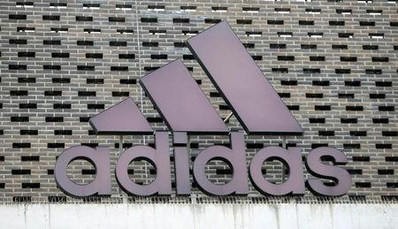 FILE PHOTO - The logo of Adidas is seen on an outlet store in Metzingen, Germany, June 16, 2017. REUTERS/Michaela Rehle