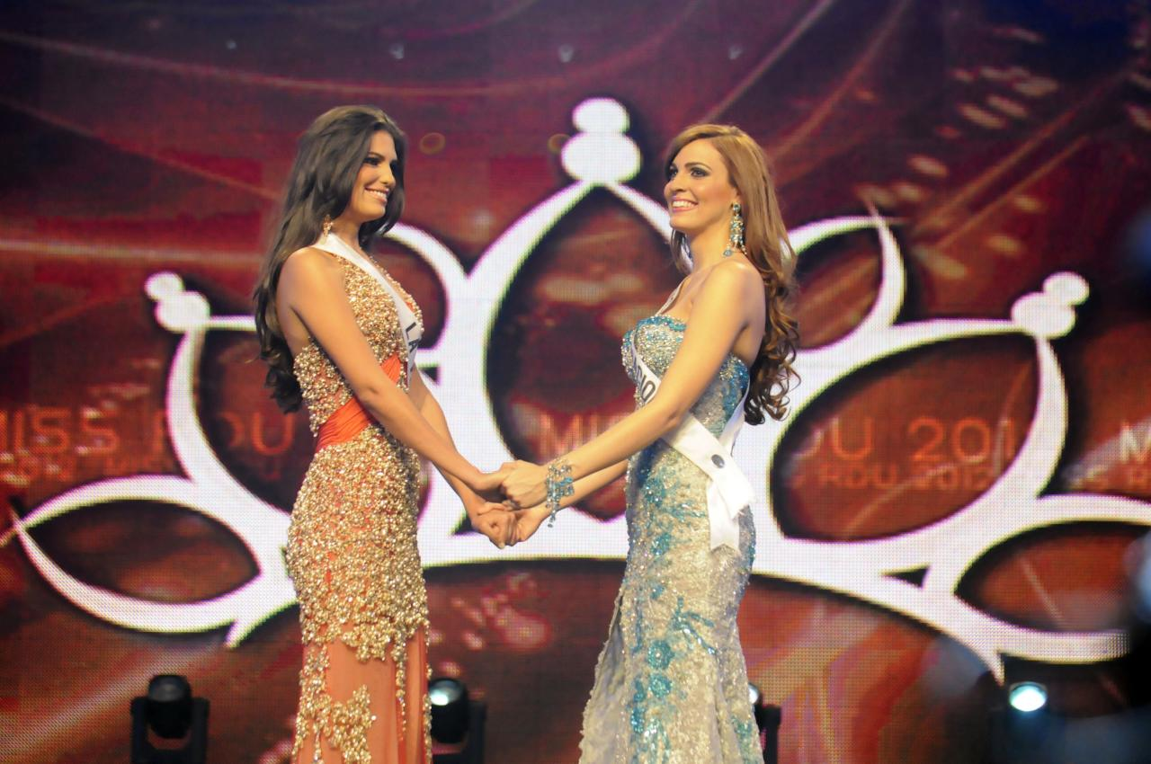In this April 17, 2012 photo, Carlina Duran, left, and Dulcita Lieggi stand together as they compete in the Miss Dominican Republic beauty pageant in Santo Domingo, Dominican Republic. Lieggi, who placed second, will represent the country in the Miss Universe international competition after Duran lost her crown due to the discovery that she wed in 2009. Miss Dominican Republic Director Magaly Febles says contestants must be single. (AP Photo/Victor Calvo)