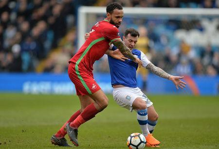 Soccer Football - FA Cup Fifth Round - Sheffield Wednesday vs Swansea City - Hillsborough, Sheffield, Britain - February 17, 2018 Swansea City's Kyle Bartley in action with Sheffield Wednesday's Ross Wallace REUTERS/Peter Powell