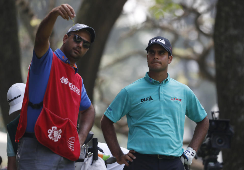 India's Shubhankar Sharma, right, talks with his caddie about his approach to the green on the 7th hole during the second round of the Mexico Championship at the Chapultepec Golf Club in Mexico City, Friday, March 2, 2018. (AP Photo/Eduardo Verdugo)
