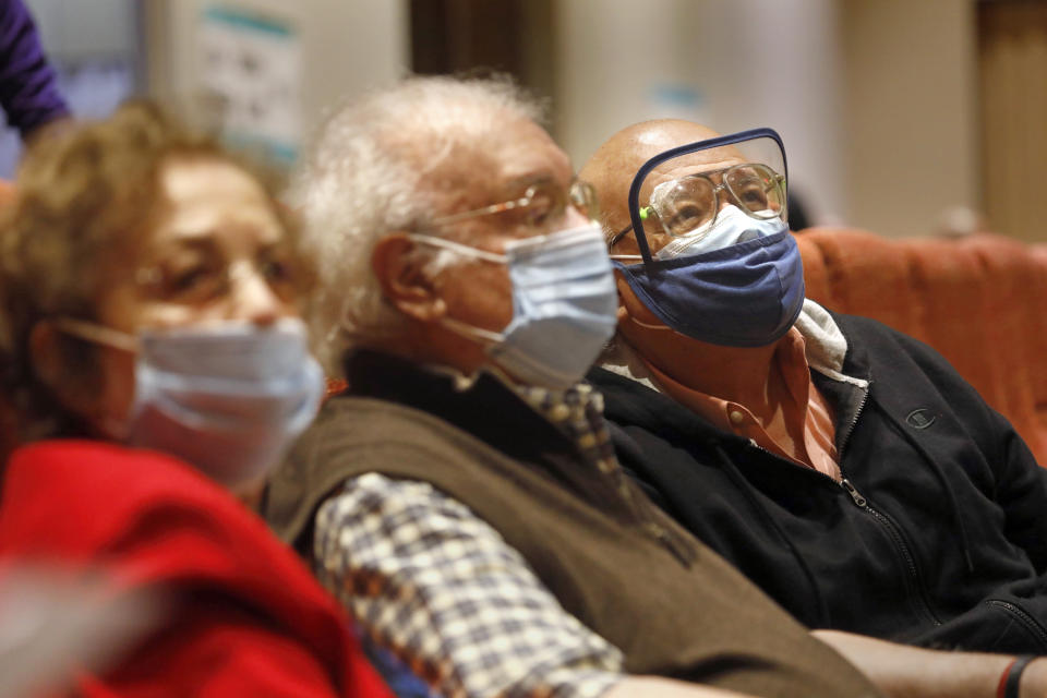 Retired Maria Elena Rodriguez sits with her husband, Miguel Meza Sanchez, center, and their son, Miguel Rodriguez, 65, right, in Edinburg, Texas. (Carolyn Cole/Los Angeles Times via Getty Images)