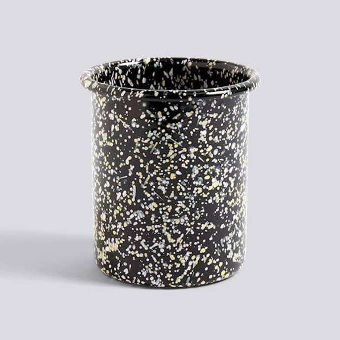 """<strong>Under £50</strong><br><br>I don't have anywhere to put my spoons. I never knew this would be an issue that would annoy me so much but here we are. This speckled HAY tub will be the perfect solution to my situation, allowing me to pop all my cooking utensils right by my hob instead of ferreting through my drawers. <br><br><strong>Hay</strong> Utensil Holder Enamel, $, available at <a href=""""https://www.trouva.com/products/hay-utensil-holder-enamel"""" rel=""""nofollow noopener"""" target=""""_blank"""" data-ylk=""""slk:Trouva"""" class=""""link rapid-noclick-resp"""">Trouva</a>"""