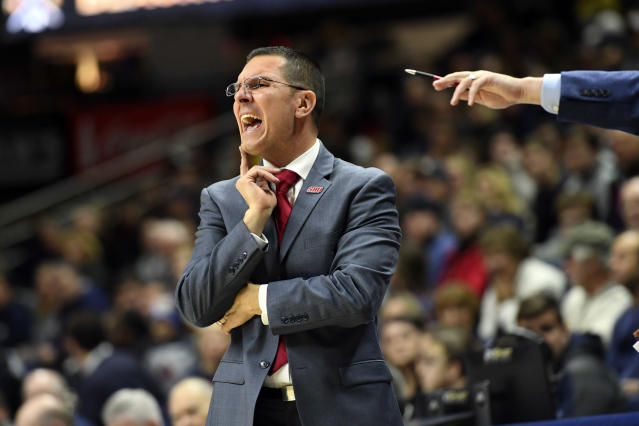Sacred Heart head coach Anthony Latina yells instructions from the sideline during the first half of an NCAA college basketball game against Connecticut, Friday, Nov. 8, 2019, in Storrs, Conn. (AP Photo/Stephen Dunn)