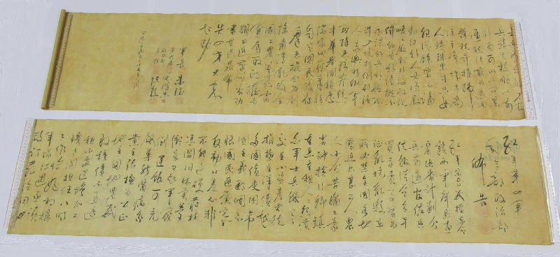 In this photo provided by Hong Kong Police Force, two pieces of a calligraphy scroll by former Chinese leader Mao Zedong estimated to be worth about $296.7 million are displayed in Hong Kong, Tuesday, Oct. 6, 2020. The South China Morning Post newspaper quoting an unnamed police source who reported that the calligraphy scroll was cut in half by a buyer who had purchased it for 500 Hong Kong dollars ($64.50) and had believed the scroll to be counterfeit. (Hong Kong Police Force via AP)