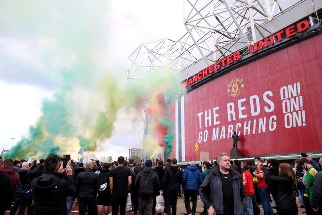 Fans let off flares as they protest outside Old Trafford