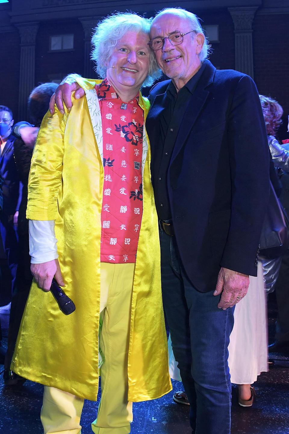 <p>Mark Oxtoby and Christopher Lloyd embrace after the curtain call during opening night of <em>Back to the Future: The Musical</em> at The Adelphi Theatre on Sept. 13 in London.</p>