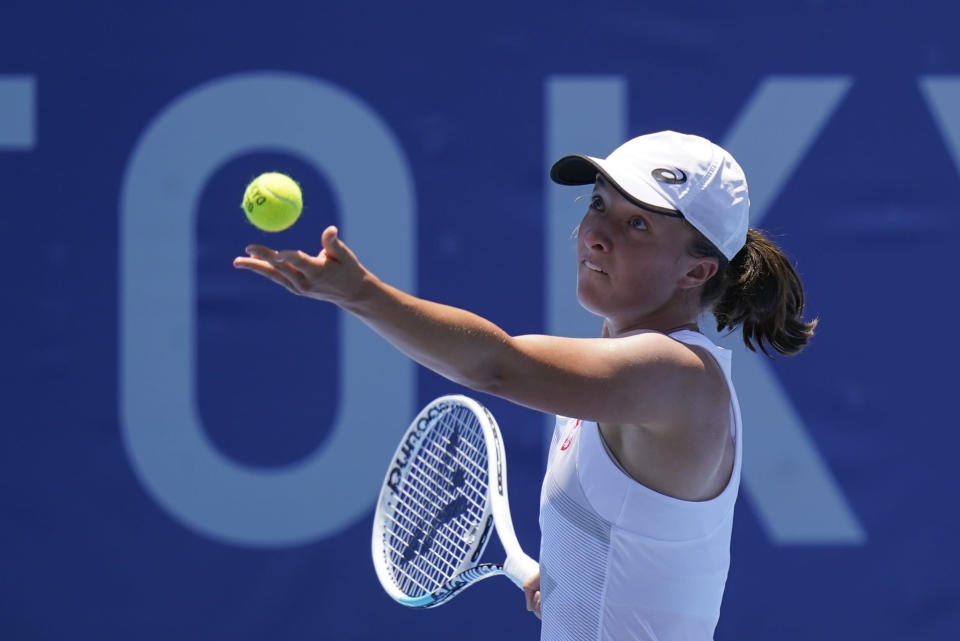 Iga Swiatek, of Poland, serves to Mona Barthel, of Germany, during the tennis competition at the 2020 Summer Olympics, Saturday, July 24, 2021, in Tokyo. (AP Photo/Patrick Semansky)
