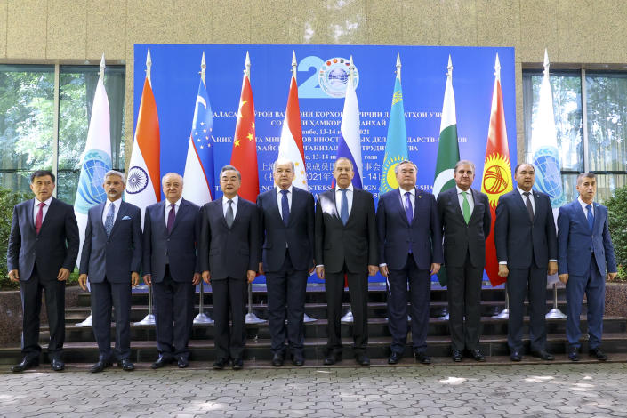 This photo released by Russian Foreign Ministry Press Service, shows from left, SCO Secretary-General Vladimir Norov, Indian Foreign Minister Subrahmanyam Jaishankar, Uzbekistani Foreign Minister Abdulaziz Kamilov, Chinese Foreign Minister Wang Yi, Tajiki Foreign Minister Sirojiddin Muhriddin, Russian Foreign Minister Sergey Lavrov, Kazakhstan's Foreign Minister Mukhtar Tileuberdi, Pakistani Foreign Minister Shah Mahmood Qureshi, Kyrgyz Deputy Foreign Minister Nuran Niyazaliev and SCO Regional Anti-Terrorist Structure (RATS) Executive Committee Director Jumakhon Giyosov pose for a photo prior to the Shanghai Cooperation Organization (SCO) meeting in Dushanbe, Tajikistan, Wednesday, July 14, 2021. Foreign ministers from Shanghai Cooperation Organisation member states hold a series of meetings in the Tajik capital Dushanbe to discuss regional issues, including the security situation in Afghanistan. (Russian Foreign Ministry Press Service via AP)