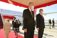 Turkish President Recep Tayyip Erdogan and, to his right, Turkish Cypriot leader Ersin Tatar shown at the Ercan Airport in Nicosia, the capital of the self-proclaimed Turkish Republic of Northern Cyprus
