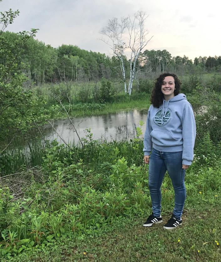 "Hannah Arbuckle in front of the Kakagon Slough on Bad River where they harvest our Manoomin (wild rice). Arbuckle says Manoomin in the Ojibwe language means ""the good berry"", and has many traditional and cultural value to us including being apart of origin story where we were told to settle ""where food grows on water"". Arbuckle has an internship working for the Great Lakes Indian Fish and Wildlife Commission, located on the Bad River Reservation."