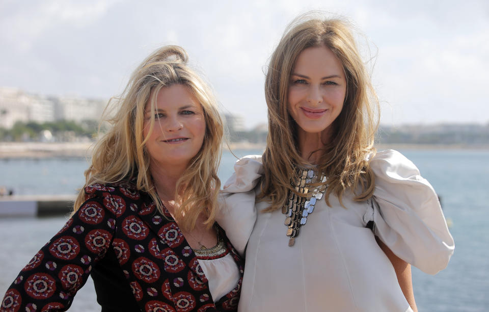 English fashion designer Susannah Costantine,left, and English fashion advisor and designer , Trinny Woodall pose during the 28th MIPCOM (International Film and Programme Market for Tv, Video,Cable and Satellite) in Cannes, southeastern France, Monday, Oct. 8, 2012. (AP Photo/Lionel Cironneau )