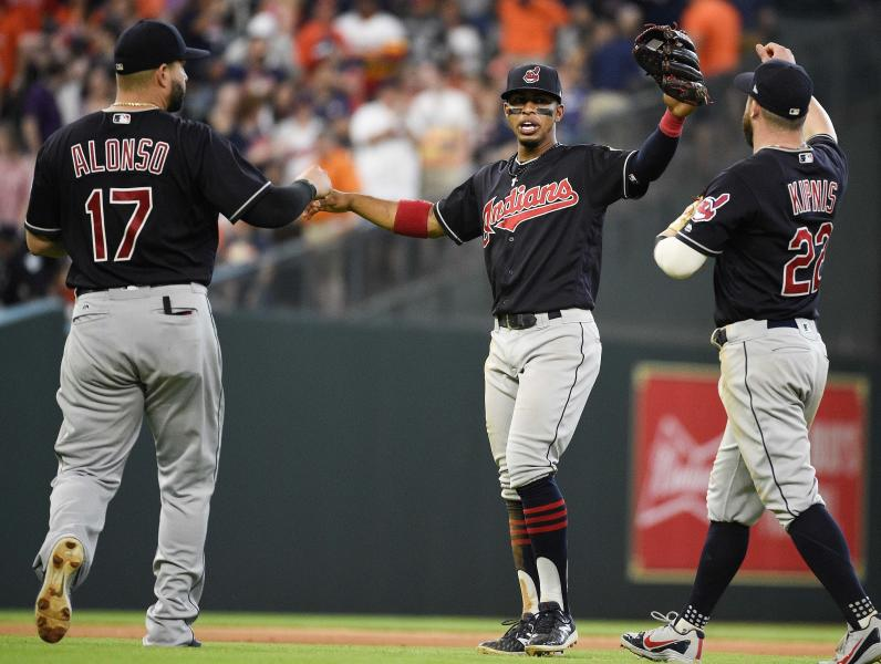 Cleveland Indians' Yonder Alonso (17), Francisco Lindor, center, and Jason Kipnis celebrate their win over the Houston Astros in a baseball game, Saturday, May 19, 2018, in Houston. (AP Photo/Eric Christian Smith)