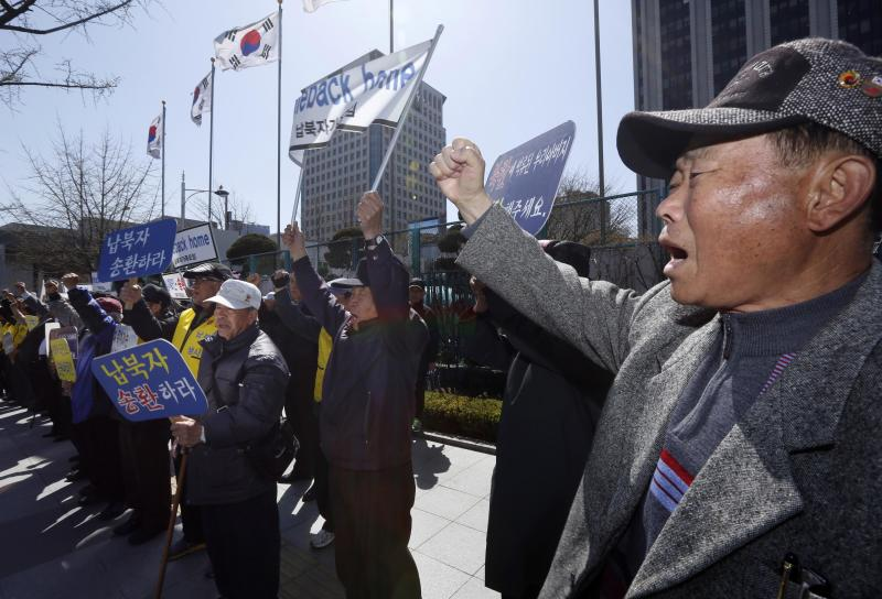 South Korean members of the Abductees Family Association attend an anti-North Korea rally in Seoul, South Korea Sunday, April 14, 2013. As the world watches to see what North Korea's next move will be in a high-stakes game of brinksmanship with the United States, residents of its capital aren't hunkering down in bunkers and preparing for the worst. Instead, they are out on the streets en masse getting ready for the birthday of national founder Kim Il Sung - the biggest holiday of the year. (AP Photo/Kin Cheung)
