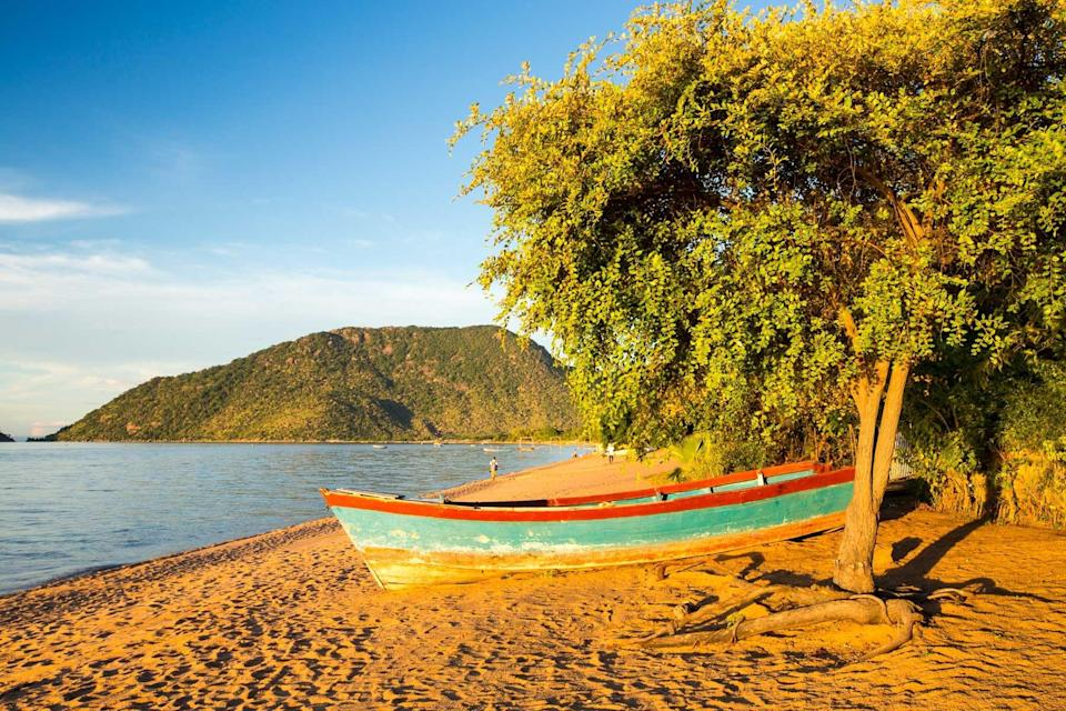 A boat on the beach at Cape Maclear on the shores of Lake Malawi, Malawi, Africa.