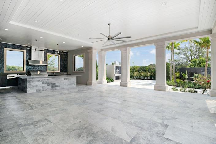The outdoor entertaining area includes a fully equipped summer kitchen.