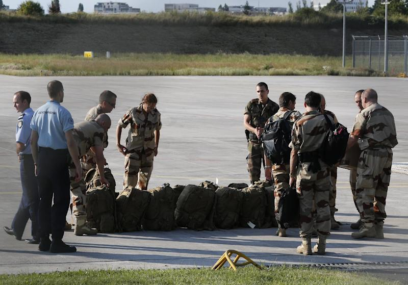 Investigators from the French Air Transport Gendarmerie and the French Criminal Analysis Unit gather their gear on July 25, 2014 at Velizy-Villacoublay's military airport before leaving for the crash site of Air Algerie flight AH5017 in Mali (AFP Photo/Francois Guillot)