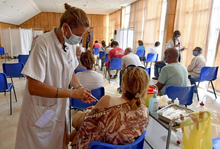 Tunisian health officials credit a rapid mass vaccination campaign with putting the brakes on a surge in Covid infections which overwhelmed hospitals across North Africa over the summer (AFP/FETHI BELAID)
