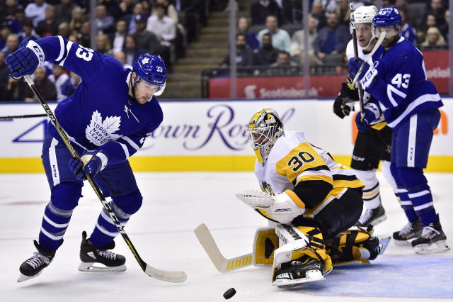 Toronto Maple Leafs centre Frederik Gauthier (33) and Pittsburgh Penguins goaltender Matt Murray (30) watch the puck during second period NHL hockey action in Toronto on Thursday, Oct. 18, 2018. (Frank Gunn/The Canadian Press via AP)
