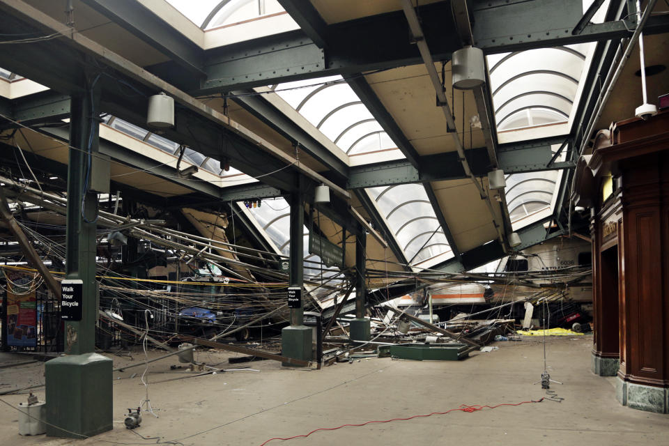 FILE - This Oct. 1, 2016, file photo, provided by the National Transportation Safety Board, shows damage done to the Hoboken Terminal in Hoboken, N.J., after a commuter train crash that killed one person and injured more than 100 others. NJ Transit has reached settlements in lawsuits filed by the family of a woman killed and people injured in a 2016 crash when a train slammed into a Hoboken station. NJ Transit spokesperson Nancy Snyder said settlements were reached in the lawsuits on Wednesday evening, May 12, 2021, NJ.com reported. (Chris O'Neil/NTSB photo via AP, File)