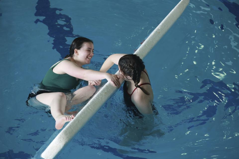 Camp counselors Meghan Haynes and Abby Adkins practice a lifeguarding technique at an indoor pool on Friday, May 21, 2021, in Santa Fe, New Mexico. Haynes, of Norman, Okla., and Adkines, of Albuquerque, trained ahead of a summer camp at the Glorieta Adventure Camp. They train in a pool because it's too cold at the camp in May. (AP Photo/Cedar Attanasio)