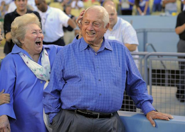 Tommy Lasorda and his wife Jo laugh as they watch a video tribute to Tommy prior to the Los Angeles Dodgers' baseball game against the Colorado Rockies, Saturday, Sept. 28, 2013, in Los Angeles. (AP Photo/Mark J. Terrill)
