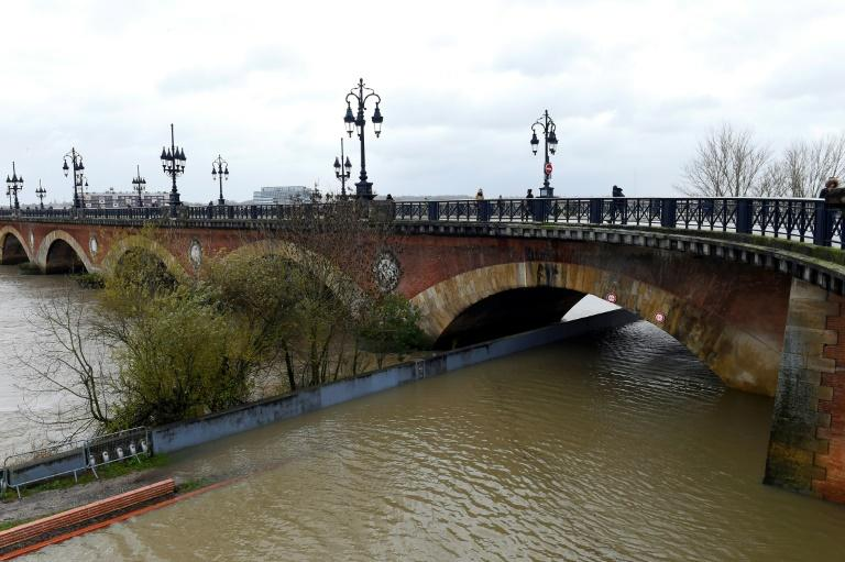 Strong winds and heavy rains pushed the Garonne river over its banks in Bordeaux, southwest France, on Friday
