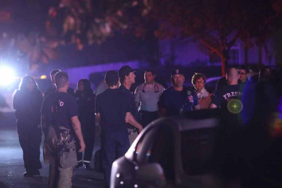 Police and emergency personnel are on the scene of a shooting at a backyard party, Sunday, Nov. 17, 2019, in southeast Fresno, Calif. (Photo: Larry Valenzuela/The Fresno Bee via AP)