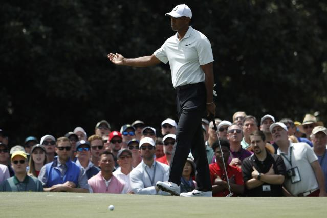 Patrons watch U.S. golfer Tiger Woods' putt miss the hole on the first green during second round play of the 2018 Masters golf tournament at the Augusta National Golf Club in Augusta, Georgia, U.S., April 6, 2018. REUTERS/Jonathan Ernst