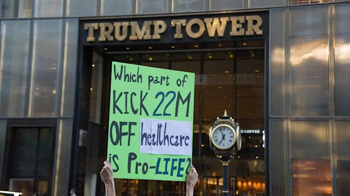 <p>A small group of activists rally against the GOP health care plan outside of the Metropolitan Republican Club, July 5, 2017 in New York City. Republicans in the Senate will resume work on the bill next week when Congress returns to Washington after a holiday recess. (Photo: Zach D Roberts/NurPhoto via Getty Images) </p>