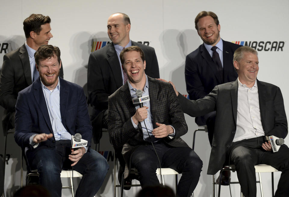 Dale Earnhardt Jr. (L) and Jeff Burton (R) will be part of NBC's experiment at New Hampshire. Brad Keselowski (C) will be driving in the race. (Jeff Siner/The Charlotte Observer via AP)