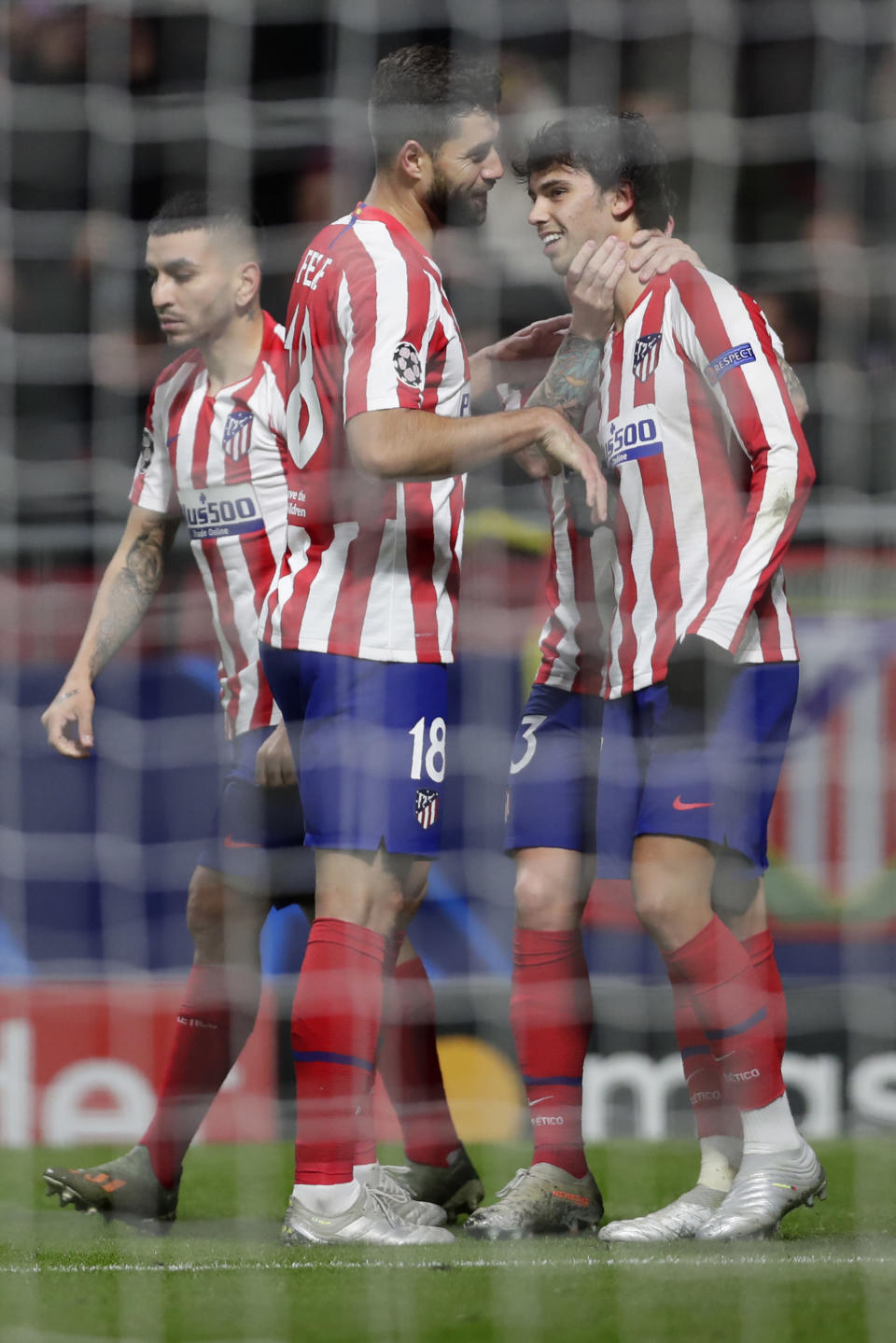 Atletico Madrid's Joao Felix celebrates with teammates after scoring the opening goal during the Champions League Group D soccer match between Atletico Madrid and Lokomotiv Moscow at Wanda Metropolitano stadium in Madrid, Spain, Wednesday, Dec. 11, 2019. (AP Photo/Manu Fernandez)