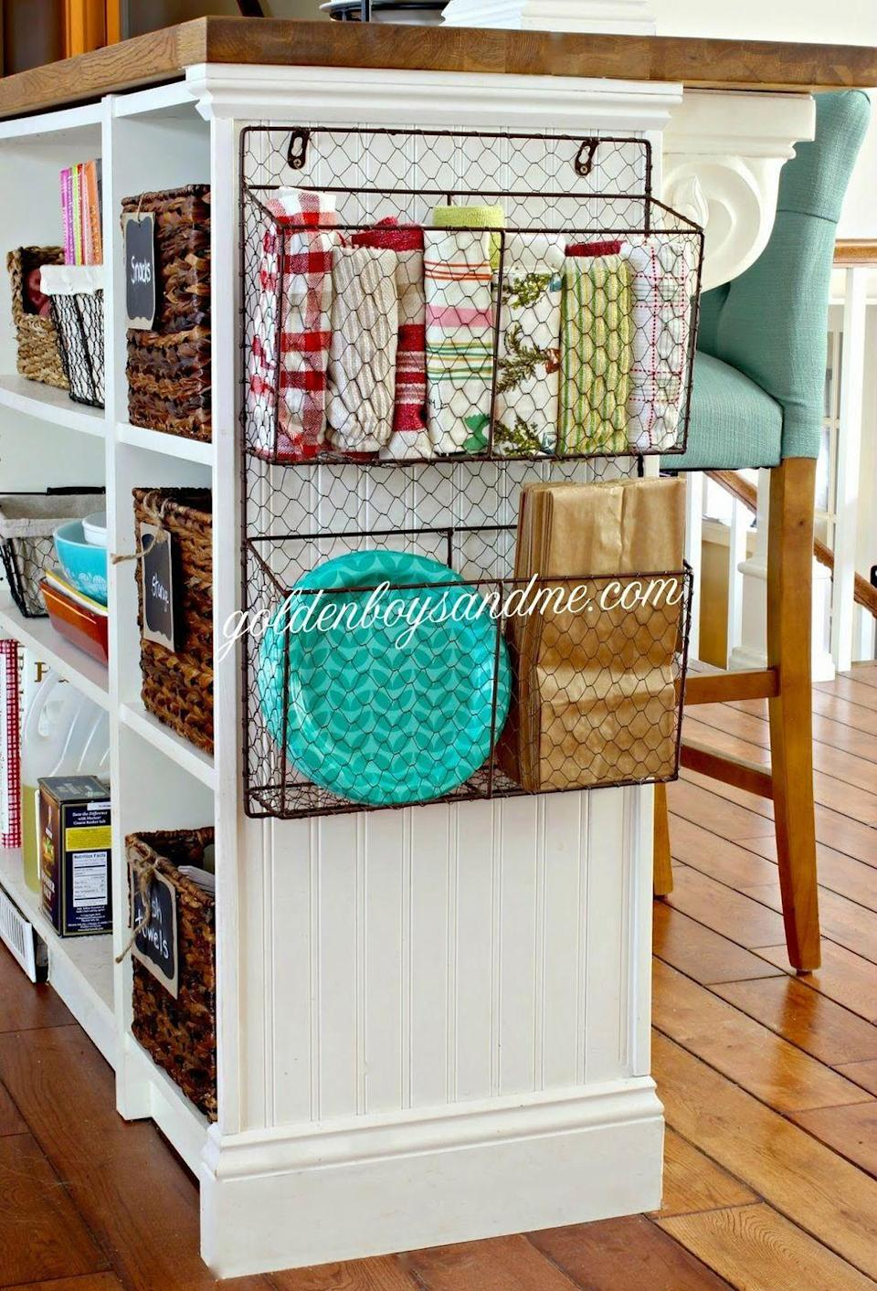 """<p>Don't overlook the side of a kitchen island (or even a bookshelf). Adding a basket takes all of three seconds, and gives you a handy spot for frequently accessed items.</p><p><a href=""""http://www.goldenboysandme.com/2014/09/wire-baskets.html"""" rel=""""nofollow noopener"""" target=""""_blank"""" data-ylk=""""slk:See more at Golden Boys and Me »"""" class=""""link rapid-noclick-resp""""><em>See more at Golden Boys and Me »</em></a></p>"""