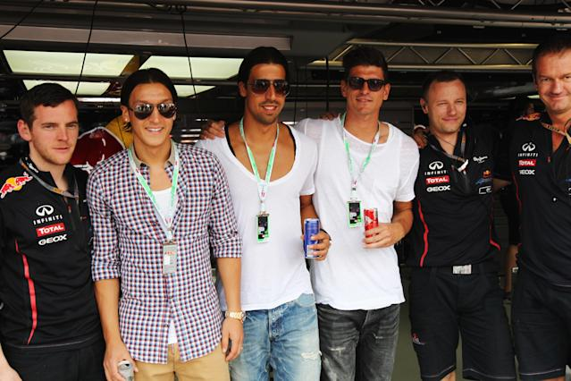 MONTE CARLO, MONACO - MAY 27: (L-R) German footballers Mesut Oezil, Sami Khedira and Mario Gomez are seen in the Red Bull Racing garage before the Monaco Formula One Grand Prix at the Circuit de Monaco on May 27, 2012 in Monte Carlo, Monaco. (Photo by Andrew Hone/Getty Images)