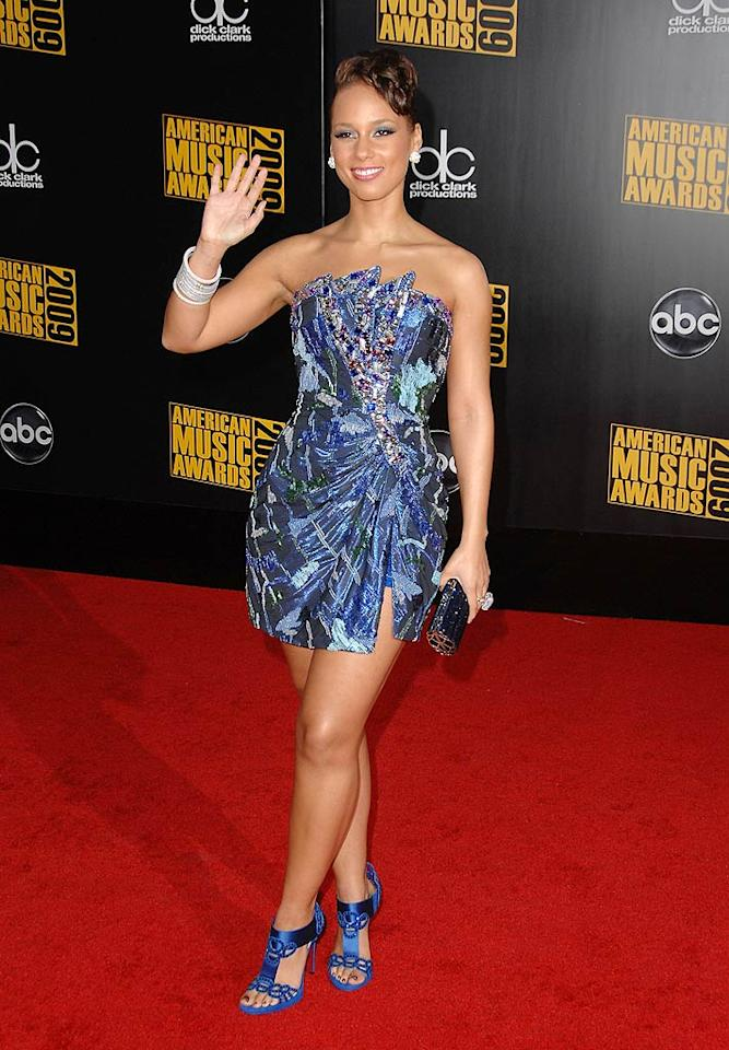 "Alicia Keys  Grade: B+  The R&B diva put her best foot forward in a blue bedazzled strapless mini, matching heels, a sophisticated updo, and tons o' bling. Steve Granitz/<a href=""http://www.wireimage.com"" target=""new"">WireImage.com</a> - November 22, 2009"