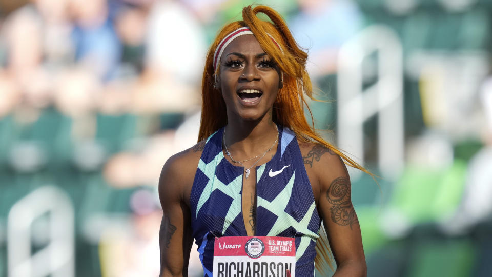 Sha'Carri Richardson celebrates after winning the first heat of the semis finals in women's 100-meter runat the U.S. Olympic Track and Field Trials Saturday, June 19, 2021, in Eugene, Ore. (AP Photo/Ashley Landis)