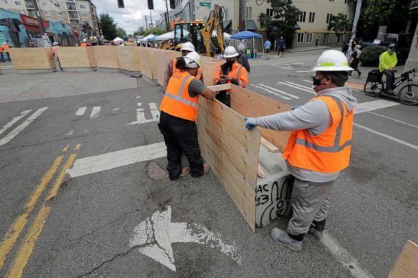 PHOTO: City workers install new cement and wood barricades, June 16, 2020, inside what has been named the Capitol Hill Occupied Protest zone in Seattle. (Ted S. Warren/AP)