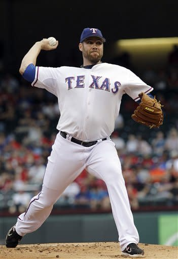 Texas Rangers starting pitcher Colby Lewis (48) throws during the first inning of a baseball game against the Kansas City Royals, Tuesday, May 15, 2012, in Arlington, Texas. (AP Photo/LM Otero)