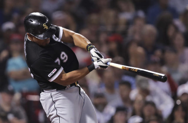 Chicago White Sox's Jose Abreu follows through on his solo home run during the sixth inning of a baseball game against the Boston Red Sox at Fenway Park in Boston, Monday, June 24, 2019. (AP Photo/Charles Krupa)