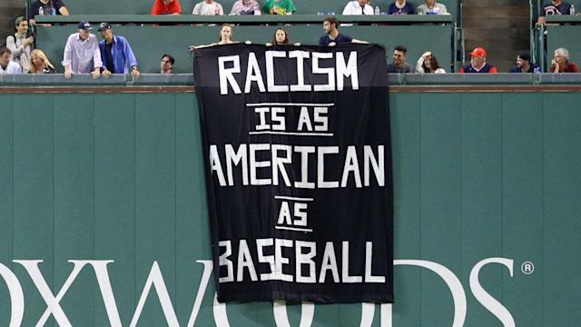 A banner unfurled at Fenway Park regarding the issue of racism in America led to some fans being ejected.