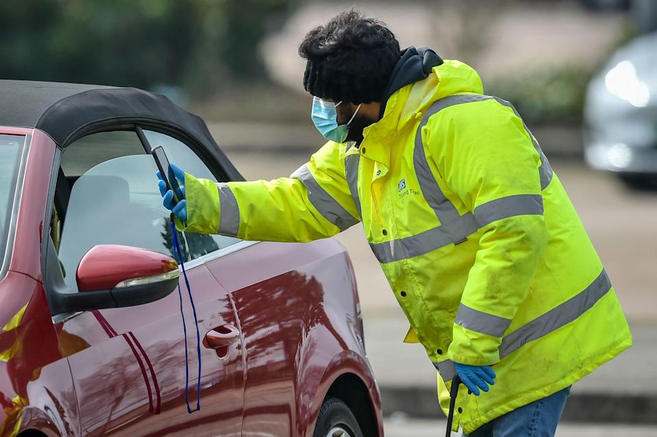 <p>Surge testing at The Mall in Cribbs Causeway, one of two sites in South Gloucestershire, after two cases of the Brazilian variant of coronavirus were identified the district</p> (PA)
