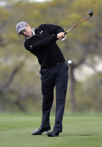 Jordan Spieth hits a shot from the fairway on the 18th hole during the first round of the Texas Open golf tournament, Thursday, April 4, 2013, in San Antonio. (AP Photo/Eric Gay)