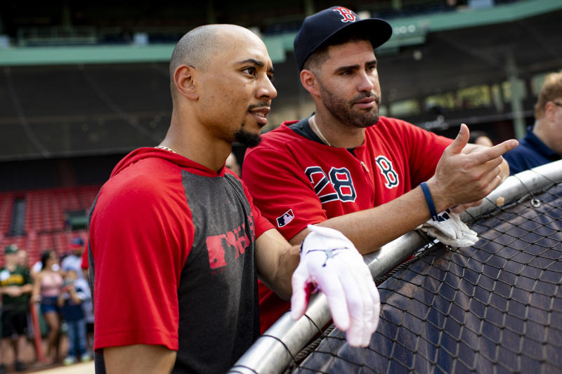 BOSTON, MA - JULY 28: Mookie Betts #50 talks with J.D. Martinez #28 of the Boston Red Sox before a game against the New York Yankees on July 28, 2019 at Fenway Park in Boston, Massachusetts. (Photo by Billie Weiss/Boston Red Sox/Getty Images)