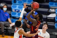 Virginia Tech guard Tyrece Radford (23) shoots over Florida guard Tre Mann (1) in the first half of a first round game in the NCAA men's college basketball tournament at Hinkle Fieldhouse in Indianapolis, Friday, March 19, 2021. (AP Photo/Michael Conroy)