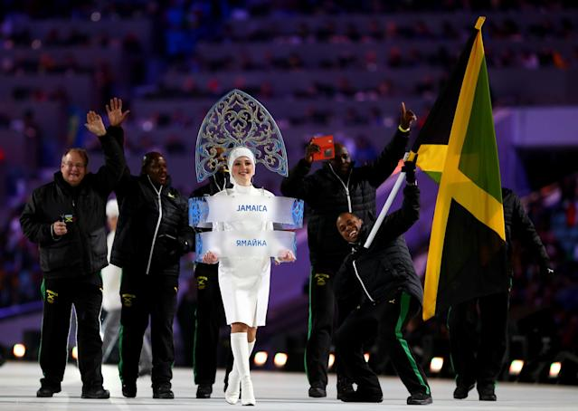 SOCHI, RUSSIA - FEBRUARY 07: Bobsleigh racer Marvin Dixon of the Jamaica Olympic team carries his country's flag during the Opening Ceremony of the Sochi 2014 Winter Olympics at Fisht Olympic Stadium on February 7, 2014 in Sochi, Russia. (Photo by Ryan Pierse/Getty Images)