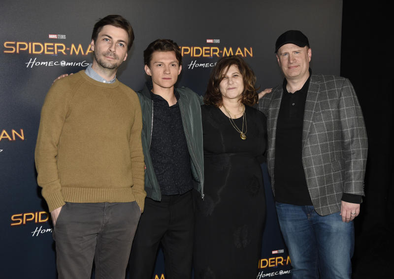 """Jon Watts, from left, director of """"Spider-Man: Homecoming,"""" poses with, cast member Tom Holland and producers Amy Pascal and Kevin Feige during a photo call backstage at the Sony Pictures Entertainment presentation at CinemaCon 2017 at Caesars Palace on Monday, March 27, 2017, in Las Vegas. (Photo by Chris Pizzello/Invision/AP)"""